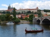 prague-castle-as-seen-from-river-with-boat