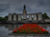 war-memorial-with-red-flowers-near-brandenburg-gate