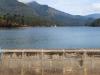 munnar-chitra-sits-on-wall-near-lake