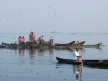 alleppey-fishermen-and-paddler