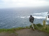 moher-intrepid-traveller-leans-over-cliff