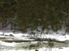 chet-kneels-at-the-frozen-river