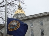 new-hampshire-flag-flies-in-front-of-dome