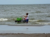 ometepe-girl-washes-clothes-in-ocean