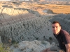 badlands-manu-poses-in-front-of-line-of-mountain-goats