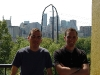 minneapolis-manu-and-mike-against-bright-city-skyline