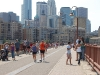 minneapolis-people-walking-along-stone-arch-bridge