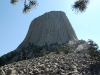 devils-tower-full-shot-with-evergreen-intrusion