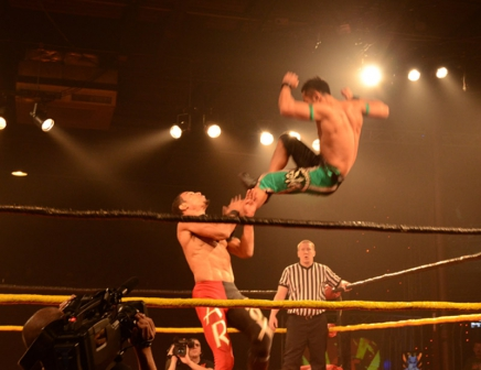 Matsato Yoshino performs a top rope dropkick on A.R. Fox
