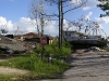 new-orleans-ship-in-street-with-flattened-house